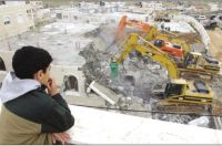 IOA hands 12 Palestinians in Al-Aghwar area demolition warnings