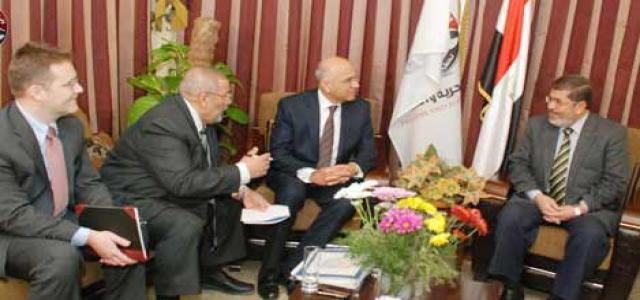 Dr. Morsi Assures IMF of His Party's Resolve to Boost Egyptian Economy, Growth, Development