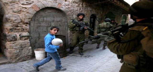 IOF soldiers force Palestinian child to drink sewage water