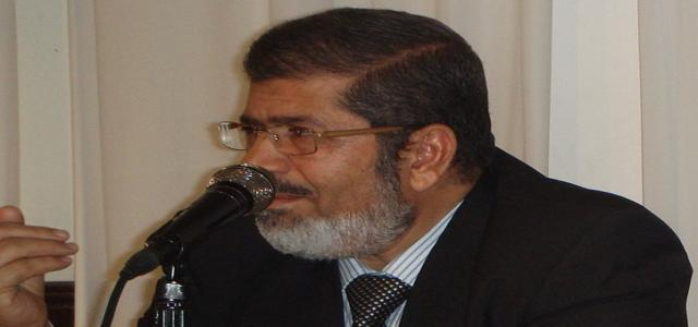 Morsi: The Majority in Parliament Will Form a Coalition Government